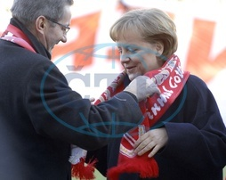Merkel,  Angela - Politician,  CDU,  Chancellor of Germany - receiving a fan scarf of the FC Energie Cottbus from Matthias Platzeck,  prime minister of Brandenburg,  she is a honorary member of this footba