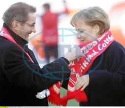 Angela Merkel - Politician,  CDU,  Chancellor of Germany - and Matthias Platzeck,  Prime Minister of Brandenburg,  receiving a fan scarf of the FC Energie Cottbus,  she is honorary member of this football