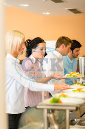 Adult, Buffet, Business, Businesswoman, Cafeteria, Caucasian, Food, Formalwear, Healthy, Indoors, Lifestyle, Lunch, Male, Meal, Office, Plate, Restaurant, Smiling, Well-dressed, Women, break, businesspeople, canteen, collea
