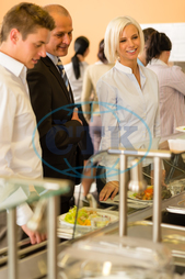 Adult, Buffet, Business, Businessman, Businesswoman, Cafeteria, Caucasian, Food, Formalwear, Healthy, Indoors, Lifestyle, Lunch, Male, Mature, Meal, Office, Plate, Ready-To-Eat, Restaurant, Serving, Smiling, Variation, Well