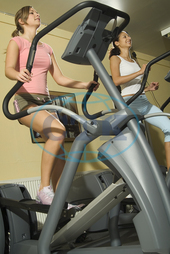 Sporty young women are doing stepp in the fitness studio