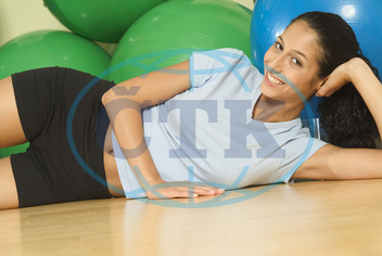 sporty young woman is lying on the floor