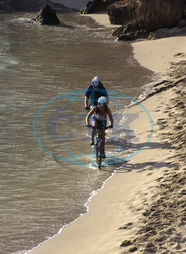 Two Mountain Bikers Driving Their Bikes