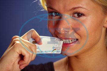Young woman with card of her health insurance