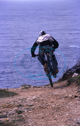 One Mountain Biker Driving his Bike