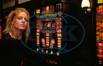 young woman at gambling machine