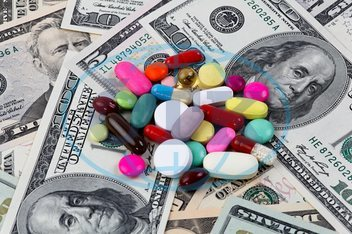 Costs for health care,  tablets and Dollar banknotes