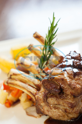 Cookery, Main Course, Cuisine, Culinary, Dinner, Dish, Food, Gourmet, Hot, Meal, Plate, Restaurant, Taste, Vegetables, Warm, Presentation, Lamb, Rack Of Lamb, Roasted, Rosemary, Sprig, Garnish, Gravy, Sauce, Rich