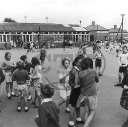 Pupils in playground,  St Luke's C of E Primary