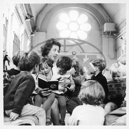 Teacher reading to infants,  Brentwood,  Essex