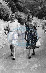 Couple on holiday in street photograph