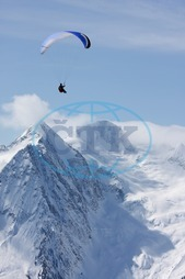 douglas noblet, noblet, not released, color image, photography, outdoor, day, horizontal, winter, paraglider, paragliding, kootenays, bc, british columbia, canada, canadian, snow, glacier, mt cooper, free flying, people,