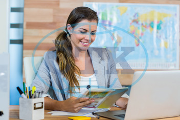 20s, Young Adult, Woman, Female, Caucasian, Indoors, Travel Agent, Occupation, Travel, Business, Map, Cartography, Journey, Destination, World Map, Exploration, Vacations, Tourist, Happy, Smiling, Cheerful, Laptop, Noteboo
