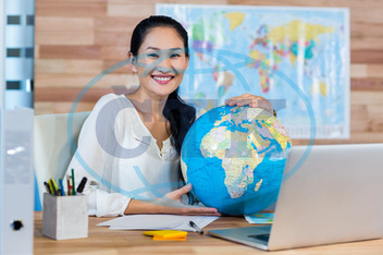 20s, Young Adult, Woman, Female, Asian, Indoors, Travel Agent, Occupation, Travel, Business, Map, Cartography, Journey, Destination, World Map, Exploration, Vacations, Tourist, Happy, Smiling, Cheerful, Globe, World, Planet