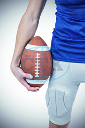20s, Young Adult, Man, Male, Caucasian, Football Player, American Football - Sport, American Football Player, Sport, Competitive Sport, Sports Uniform, Competition, Sports Clothing, Holding, Ball, Hand, Playing, Aside