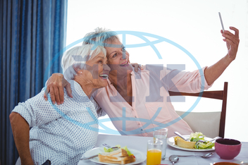 70s, Senior, Elderly, Woman, Female, Caucasian, 60s, Elderly, Retired Home,  Communication, Speaking, Discussion, Smiling, Cheerful, Happy, Happiness, Golden Years, Together, Friends, Closeness, Bonding, Affection, Free Ti