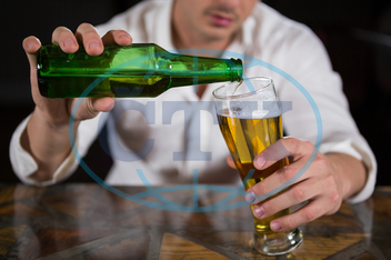 20s, Young Adult, Man, Male, Caucasian, Nightclub, Bar, Restaurant, Bar Counter, Casual, Sitting, Night Out, Drunk, Beer, Alcohol, Beer Glass, Beer Bottle, Beverage, Drink, Pouring, Refreshment, Spare Time, Free Time, Tense