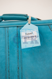 Close-up Of Travel Insurance Label Tied To A SuitcaseWhite Background, Blue, Tag, Label, Tied, Handle, Suitcase, Luggage Bag, Luggage, Text, Insured, Business, Vacation, Travel, Tourism, Journey, Trip, Insurance, Secu