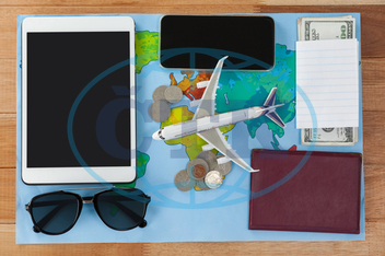 Concept, Conceptual, Travel, Traveler, Map, World Map, Aeroplane, Toy Aeroplane, Accessories, Sunglasses, Coin, Note, Cash, Dollar, Money, Passport, Currency, Finance, Wealth, Economy, Web, Internet, Digital Tablet, Tablet