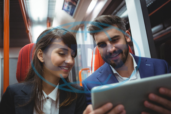 Railway, Rail, Train, Compartment, Pole, Profession, Occupation, Expertise, Business, Business Travel, Businessman, Businesswoman, Smart Casual, Smiling, Cheerful, Looking, Sitting, Using, Digital Tablet, Tablet Pc, Tabl
