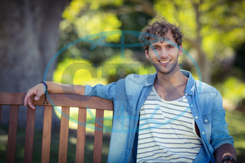 20s, Young Adult, Man, Male, Caucasian, Park, Parkland, Countryside, Summer, Sunny, Casual Clothing, Sitting, Smiling, Cheerful, Happy, Bench, Leisure, Lifestyle, Handsome, Confidence, Spare Time, Free Time, Vacation, Holid