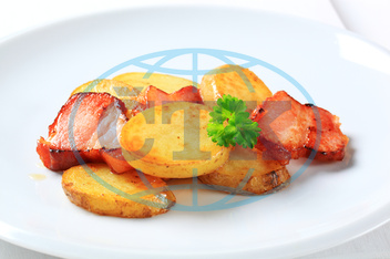 Pan fried potato slices and bacon