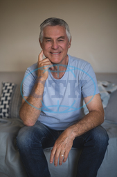 60s, Senior, Elderly, Man, Male, Caucasian, Home, Lifestyle, Leisure, Casual, Gray Hair, Wall, Apartment, Domestic Life, Retirement, Spare Time, Free Time, Confident, Confidence, Pensioner, Retired, Aging Process, Smiling,