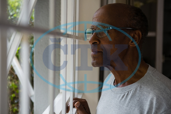 70s, Senior, Elderly, Man, Male, Black, Thoughtful, Eyeglasses, Looking Through Window, Looking, Window, Home, Lifestyle, Leisure, Casual, Retirement, Pensioner, Spectacles, Standing, Gray, Solitude, Spare Time, Free Time,