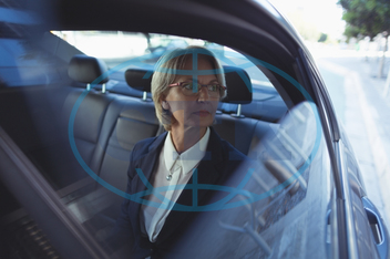 50s, Mature Adult, Woman, Female, Caucasian, Businesswoman, Window, Car, Transportation, Mode Of Transportation, Travel, Land Vehicle, Sitting, Business Travel, Eyeglasses, Short Hair, Blond Hair, Confidence, Smart Cas