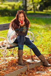Caucasian, adult, alone, apple, attractive, autumn, beautiful, bench, brunette, cardigan, casual, cheerful, eating, elegant, fall, fashion, female, happy, leisure, mid-aged, nature, one, outdoors, outfit, outside, park, portra