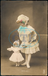 GIRL WALKING WITH DOLL