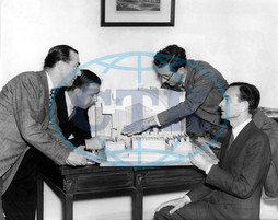 TAKE MY LIFE from left - Producer ANTHONY HAVELOCK-ALLAN,  Director RONALD NEAME,  Production Designer JOHN BRYAN and colleague DAVID LEAN examine the scale model of the No 1,  Central Criminal Court at