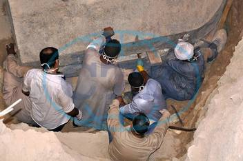 180719 ALEXANDRIA EGYPT July 19 2018 Archaeologists work at the site of sarcophagus